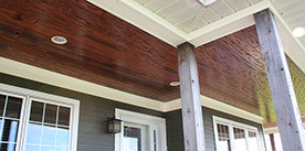 E-Peck Cypress in Auburn Color exterior patio wood ceiling. Rich coloring and natural pecky look!